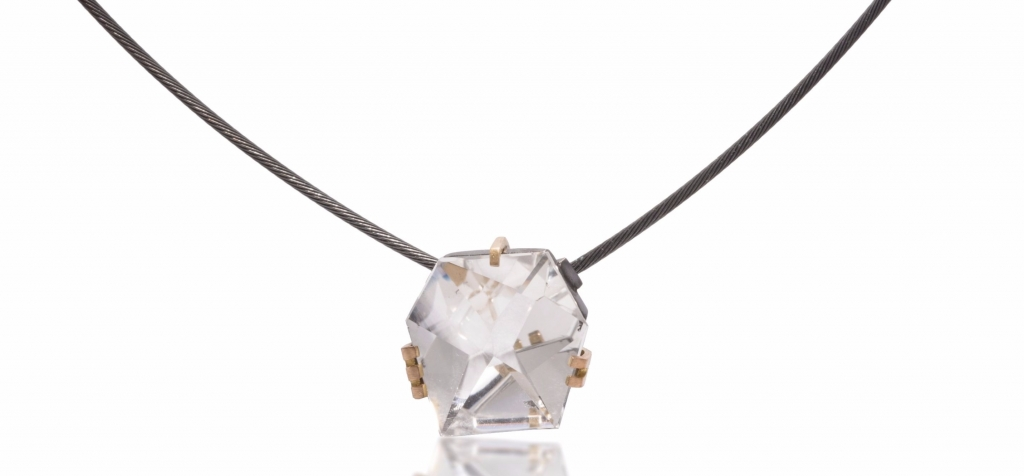 Facets necklace in oxidized sterling and 18k gold with a 12 ct. crystalline quartz, $1,230; Elizabeth Garvin