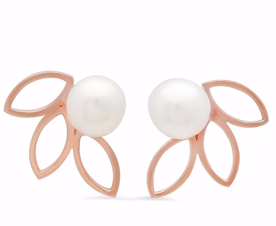 Penrose earrings in 14k rose gold with 8 mm. freshwater button-shape pearls, $694; Victoria Six Jewelry