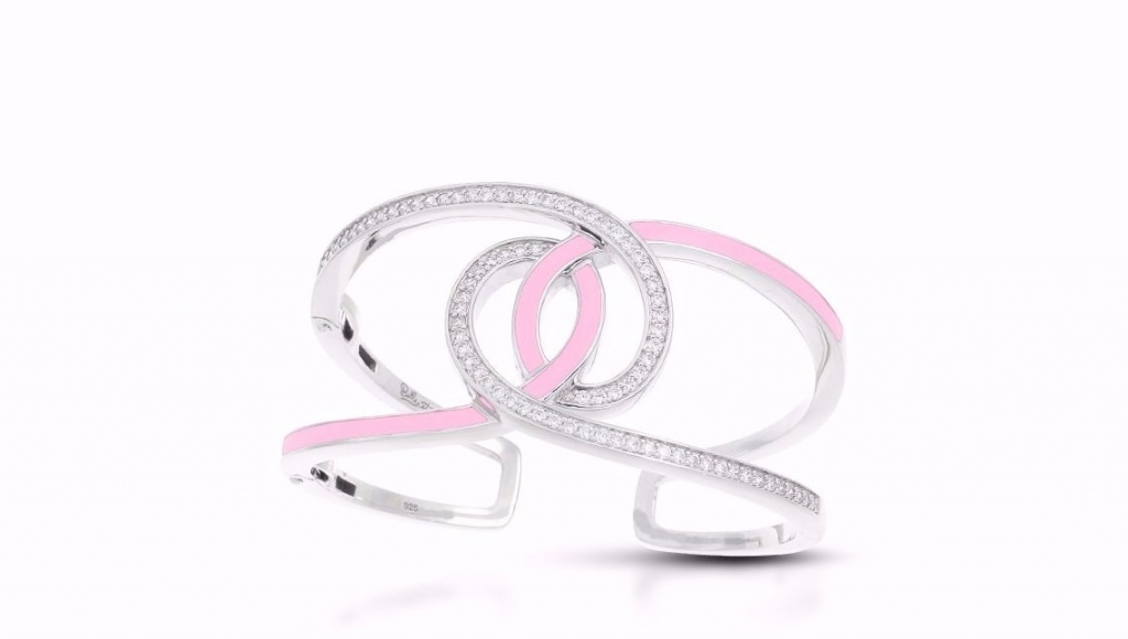 Evermore cuff in sterling silver with pink enamel, $495; Belle Étoile Twenty percent of sales are given to the Breast Cancer Research Foundation.