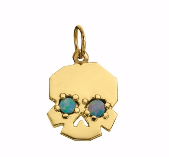 Facette skull charm in recycled 18k yellow gold opal doublets, $640; Delphine Leymarie For purchase: Buy online at Delphine Leymarie