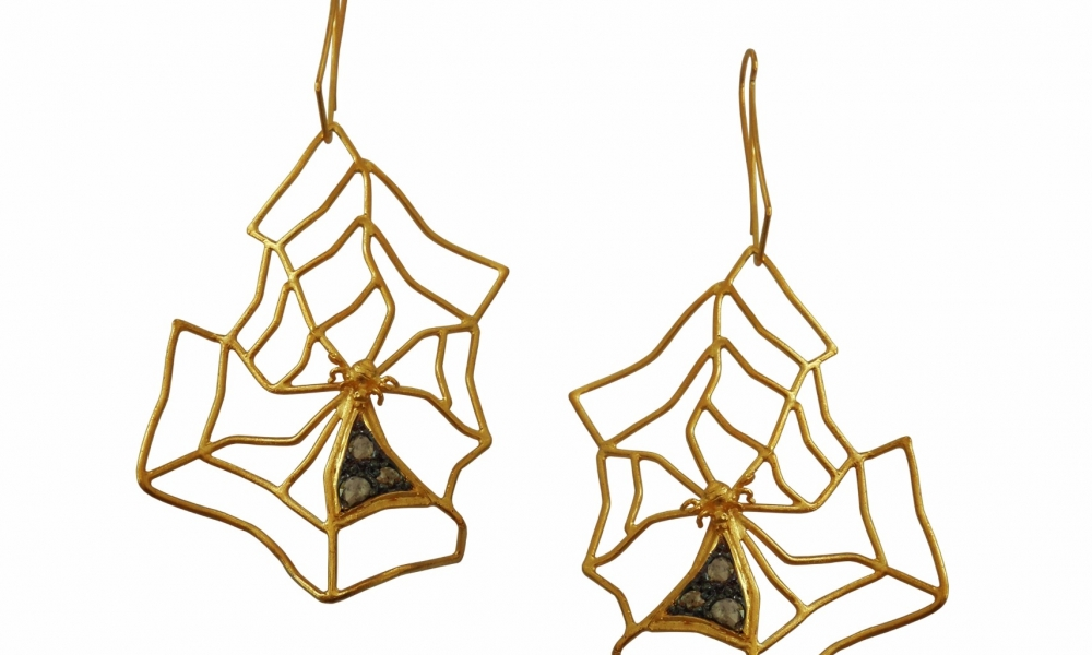 Spiderweb earrings in 18k white and yellow gold with blackened platinum and 1.2 cts. t.w. rose-cut diamonds $3,600; Thyreos Vassiliki For purchase: Buy from Thyreos Vassiliki at info@thyreosvassiliki.comor 30-69-4477-1320