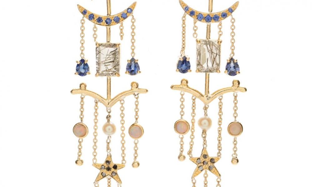 One-of-a-kind Magic Pagoda earrings in 18k gold with 1.2 cts. t.w. star sapphires, 0.79 ct. t.w. blue sapphires, 0.25 ct. black diamonds, rutilated quartz, opals, and akoya pearls, $5,400; Unhada For purchase: Buy at Blue Tree in New York City at 212-369-2583