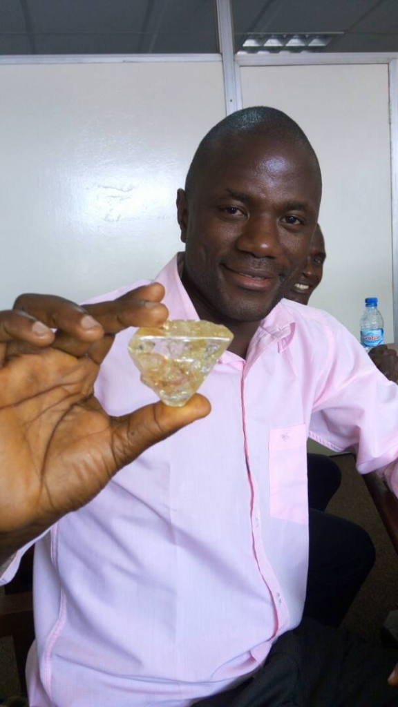 Pastor Emmanuel Momoh holds the Peace Diamond