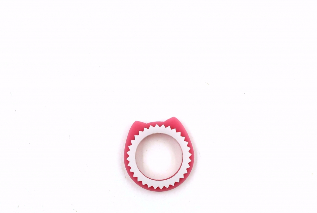 Two stackable Kitty rings in pink and white Lucite, $39; Laila Farcas-Ionescu