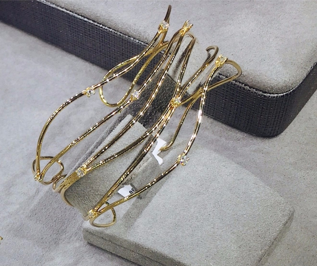 The Wave cuff in 18k yellow gold with diamond accents from Fern Freeman