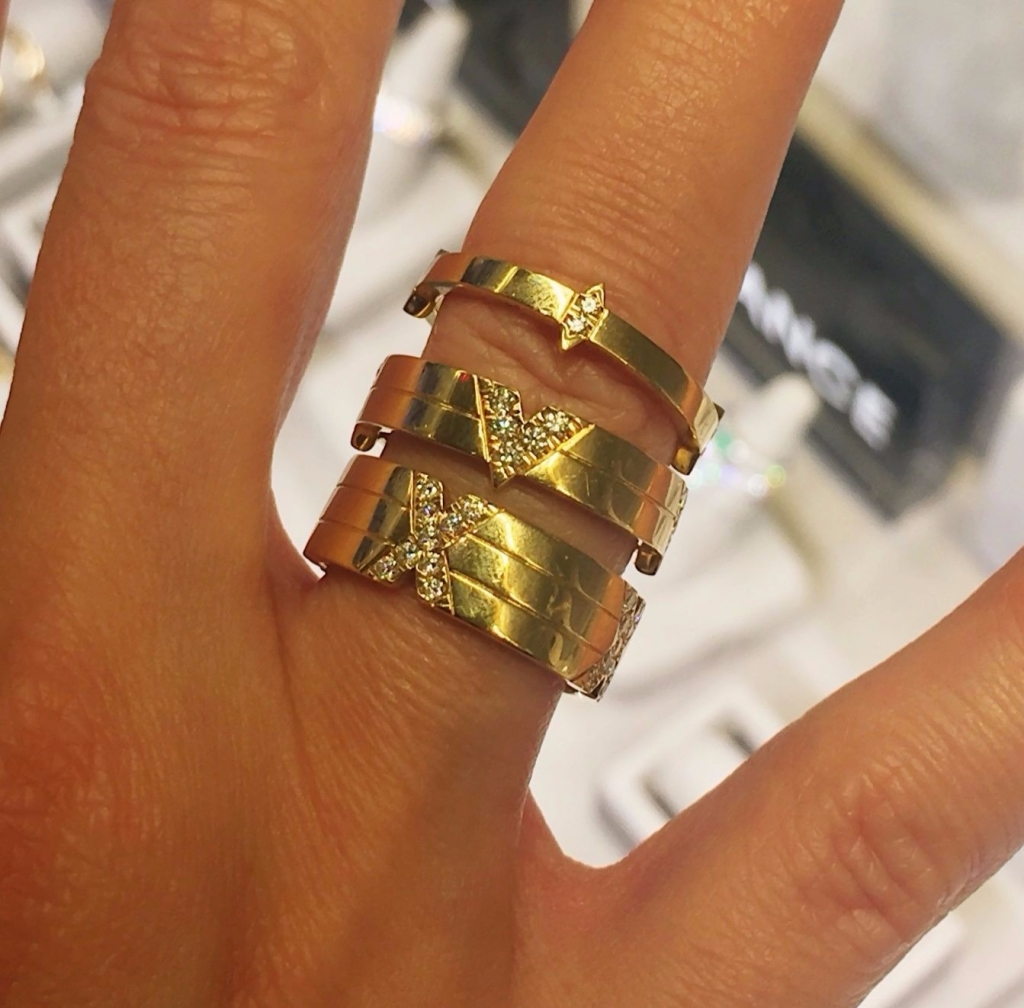 Stackable anniversary bands in 18k yellow gold with diamond-dusted Roman numerals to mark the year by Lindsey Scoggins