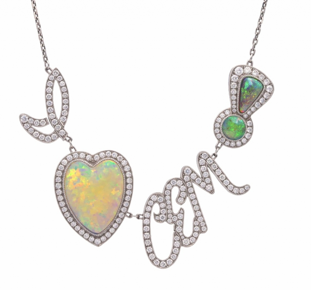 A heart-shape opal necklace from Deirdre Featherstone. The sentence is a love note to her daughter.
