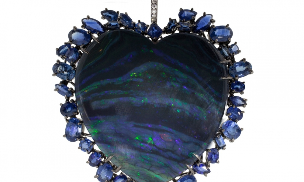 One-of-a-kind pendant necklace in 18k white gold with black rhodium and a 56.31 ct. heart-shape black opal with blue sapphires, $45,925; Kimberly McDonald For purchase: Call Bergdorf Goodman at 212-753-7300.