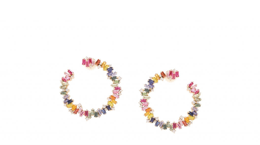 Rainbow Fireworks Spiral Hoop earrings in 18k yellow gold with 8.2 cts. t.w. baguette-cut multicolored sapphires and 0.44 ct. t.w. round colorless diamonds are 30 mm in size, $7,600 Purchase online at Suzanne Kalan