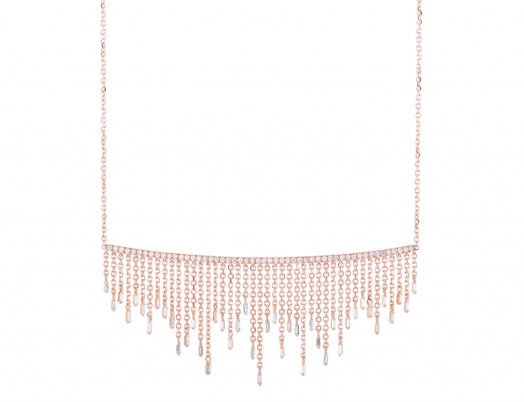 Cascade Fireworks Short Fringe necklace in 18k yellow gold with 0.65 ct. t.w. colorless baguette-cut diamonds and 0.4 ct. t.w. round diamonds on a 16-inch adjustable chain, $6,000 Purchase online at Suzanne Kalan