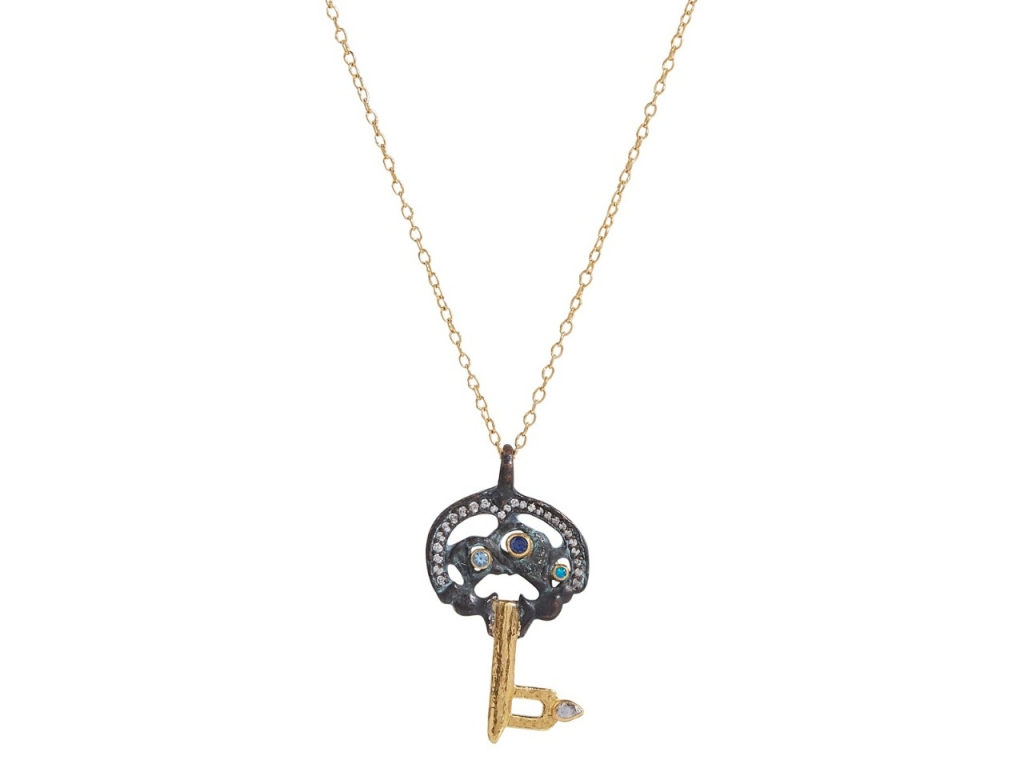 Pendant necklace in 22k–24k gold extends to 22 inches in length and features an original bronze 9th Century Viking key with 0.164 cts. t.w. colorless diamonds, 0.01 ct. t.w. rose-cut diamonds, 0.02 ct. t.w. opal, and 0.08 ct. t.w. blue topaz, $4,950; email Alice@gurhan.com at Gurhan for purchase.