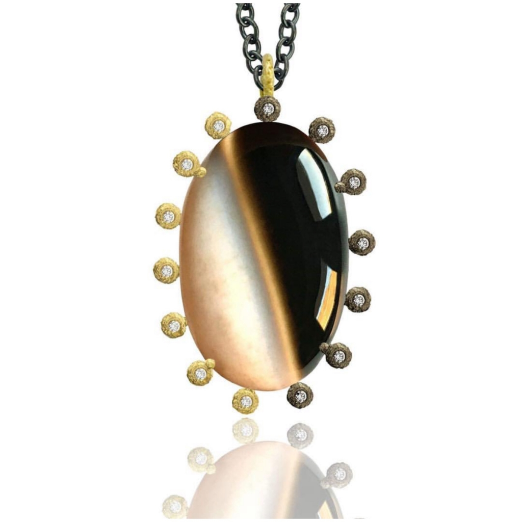 Pendant necklace in 18k yellow gold and oxidized silver with a 40 ct. agate and 0.21 ct. t.w. brown diamonds, $2,800; email Laurie@lauriekaiser.com at Laurie Kaiser for purchase