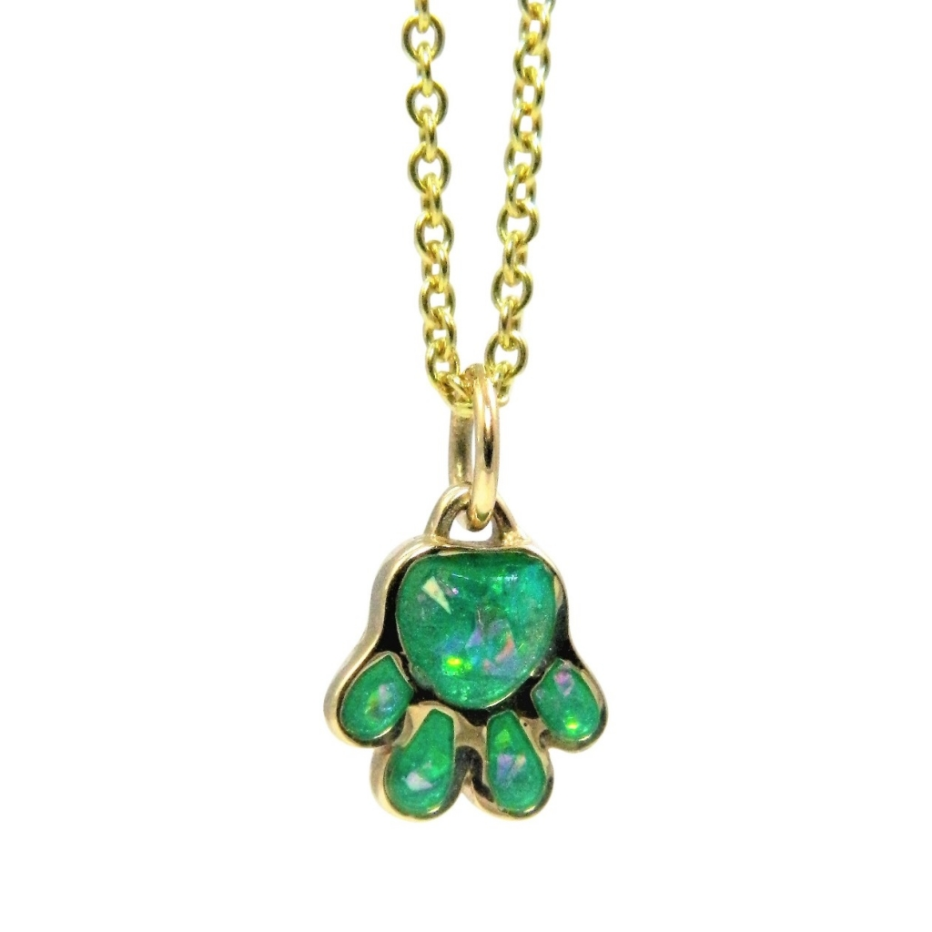Paw pendant in 14k yellow gold with opalized enamel, $500; email alisonknagasue@gmail.com at Alison Nagasue for purchase