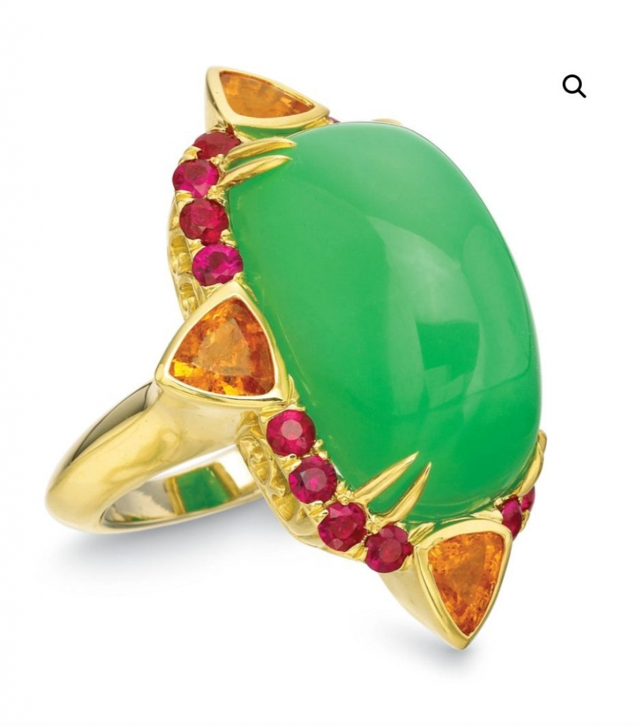 Jawbreaker ring in 18k yellow gold with a 31.95 ct. chrysoprase, 7.75 cts. t.w. trillion-shape spessartite garnets, and 2.25 cts. t.w. rubies, $14,900; call 214-402-4952 at Andrew Glassford Jewels for pricing and purchase