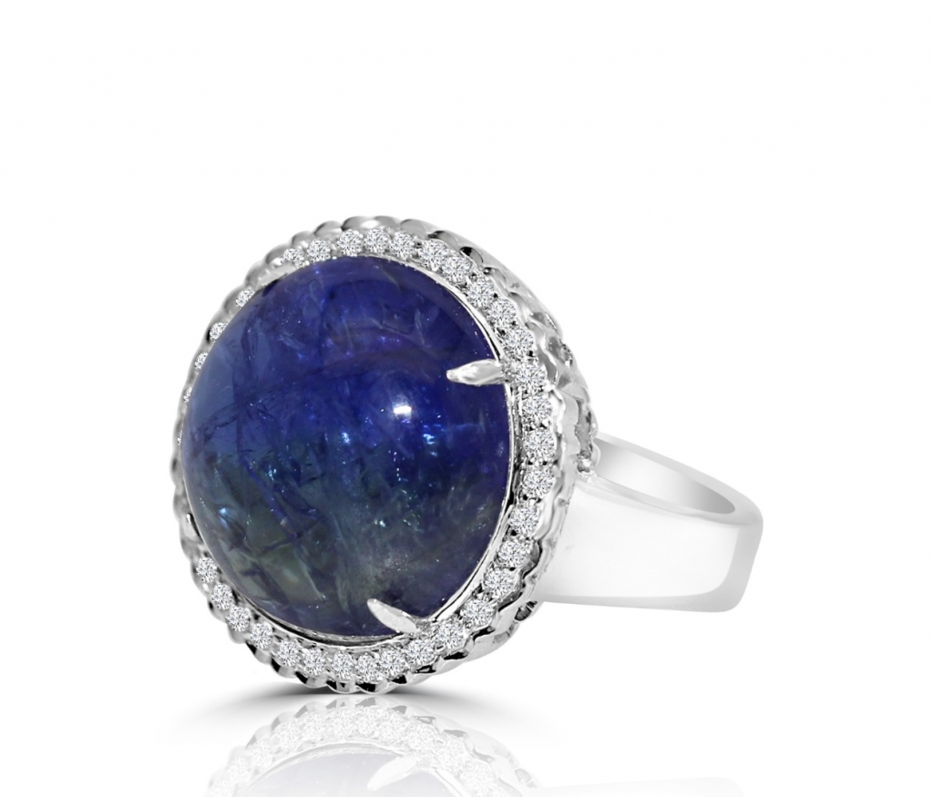 Ring in 18k white gold with a 12 ct. cabochon-cut, bi-color tanzanite and 0.25 ct. t.w. diamonds, $3,200; email studio@vivaan.us at Vivaan for purchase
