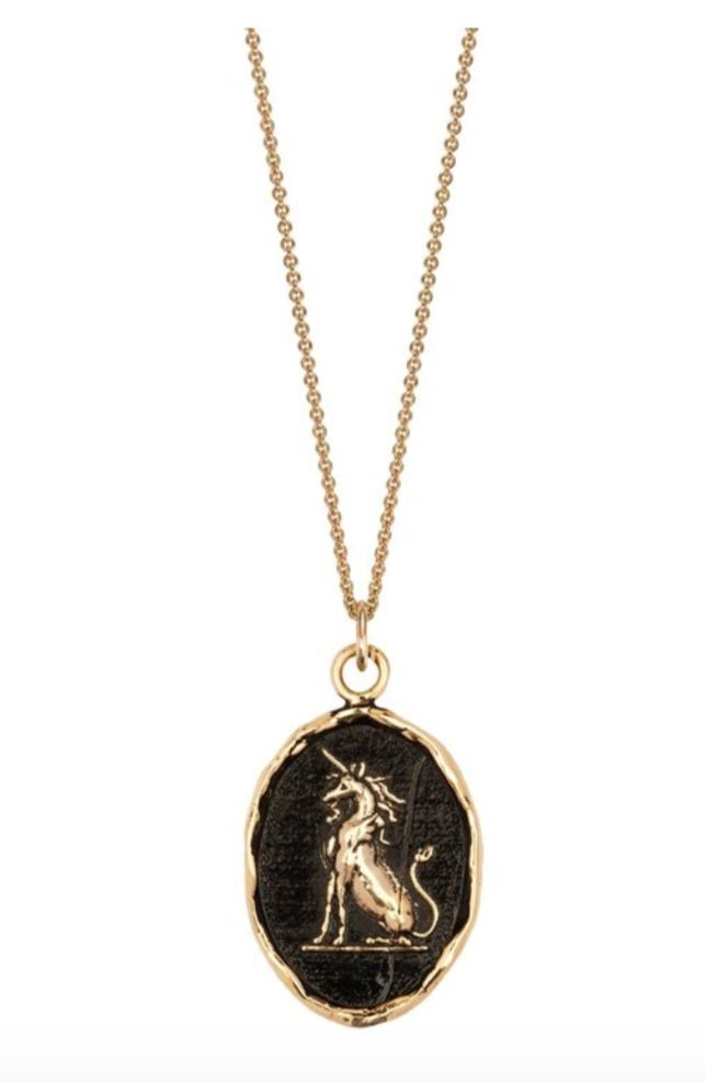 Power to heal talisman necklace with a unicorn motif is in 14k gold on a 16-inch chain, $666; Pyrrha