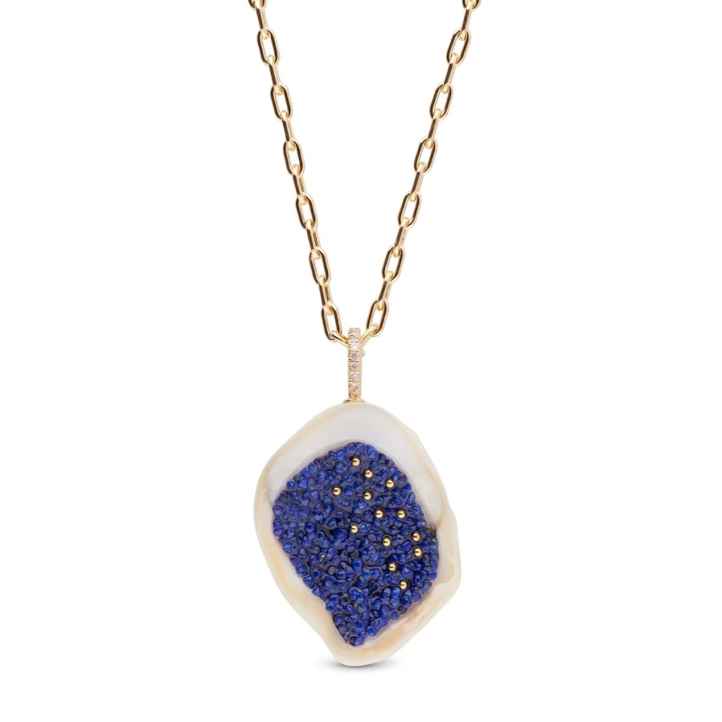 Pendant necklace in 14k yellow gold with a sliced freshwater Souffle pearl inset with faceted lapis beads and 22k gold granules to look like a geode, $3,000; email hisano@littlehjewelry.com at little h jewelry for purchase