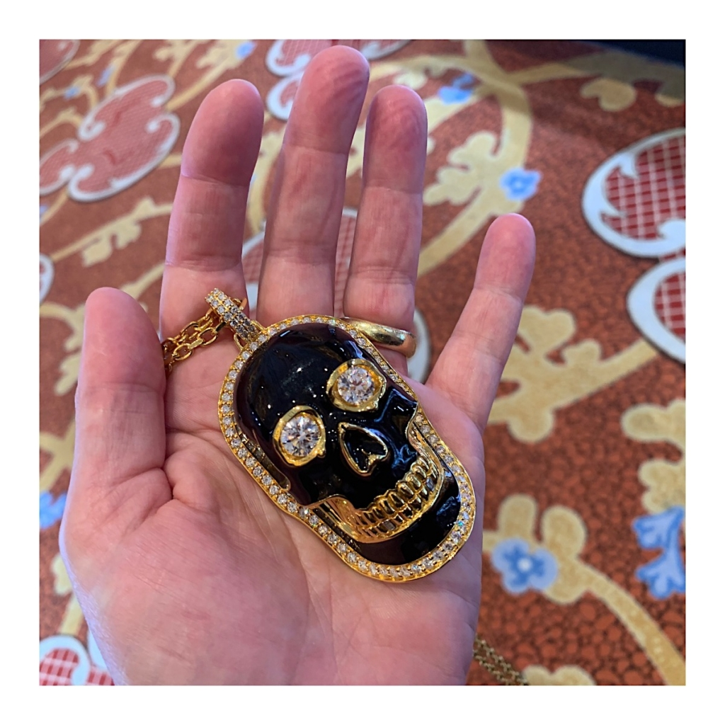 Happy skull in enamel, gold, and diamonds from Buddha Mama