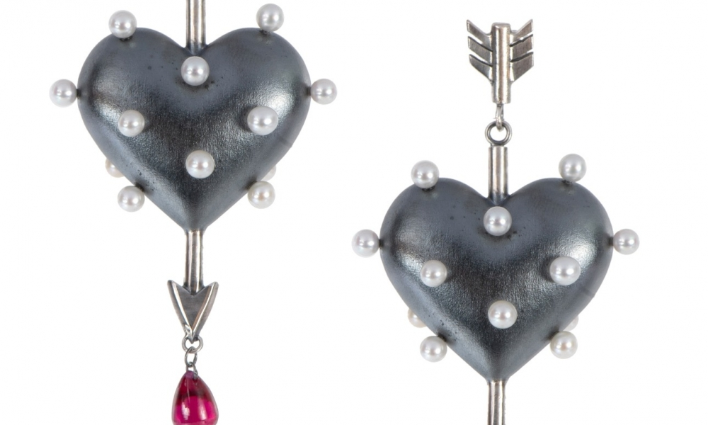 Pin Cushion Through the Heart earrings in oxidized sterling silver with freshwater pearls and heat-treated rubies, $920; Rachel Quinn