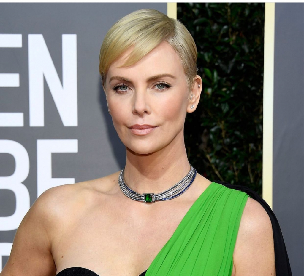 "Charlize Theron, presenter and nominee for Best Performance by an Actress in a Motion Picture Drama for ""Bombshell,"" in a diamond and emerald choker from the Blue Book collection of Tiffany & Co. Photo: @tiffanyandco"