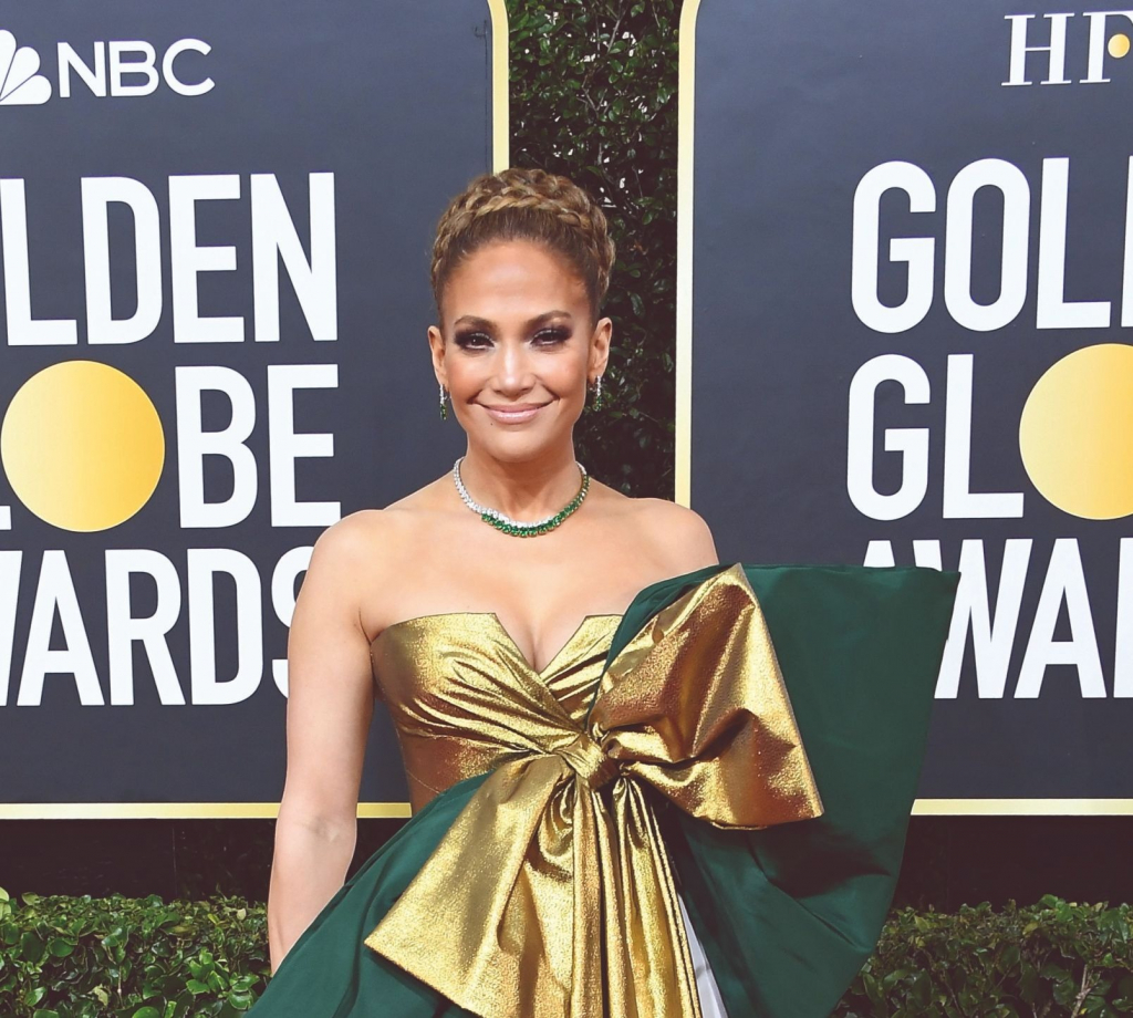 "Jennifer Lopez, presenter and nominee for Best Actress in a Supporting Role in Any Motion Picture for ""Hustlers,"" in an emerald and diamond necklace in 18k gold and platinum from Harry Winston.  Photo: Harry Winston/Steve Granitz/Getty Contributor"