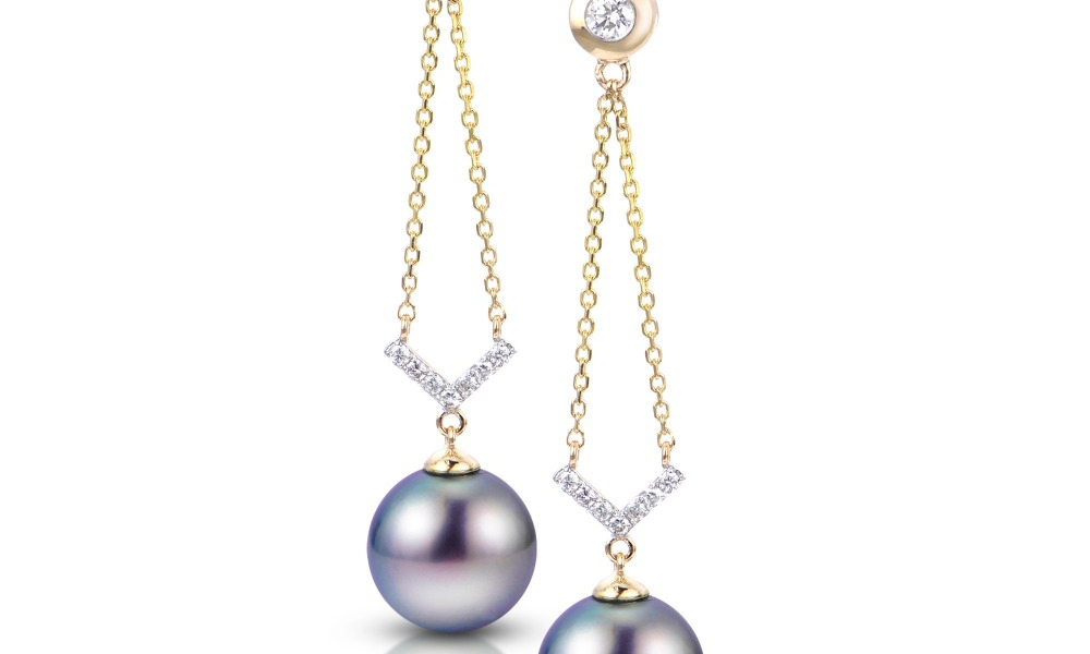 Earrings in 14k yellow gold with peacock-color Tahitian pearls and diamond accents, $1,760; available online at Montica Jewelry