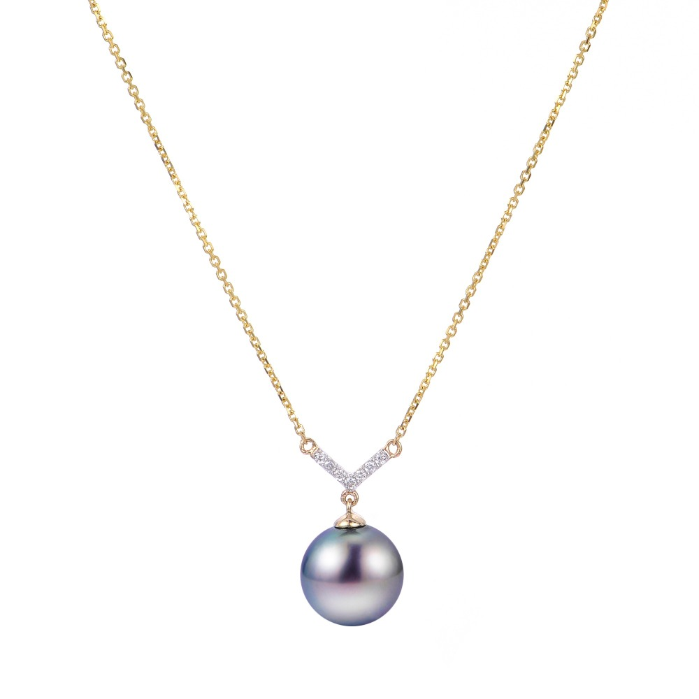 Necklace in 14k yellow gold with a peacock-color Tahitian pearl and diamond accents, $875; available online at Montica Jewelry