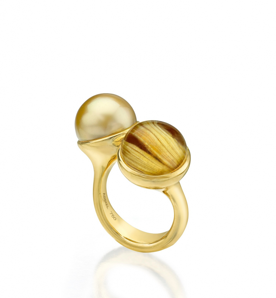 Ring in 18k yellow gold with a 12.32 mm golden South Sea pearl and 13.38 ct. rutilated quartz, $9,800; by Assael, email emoffitt@assael.com for purchase