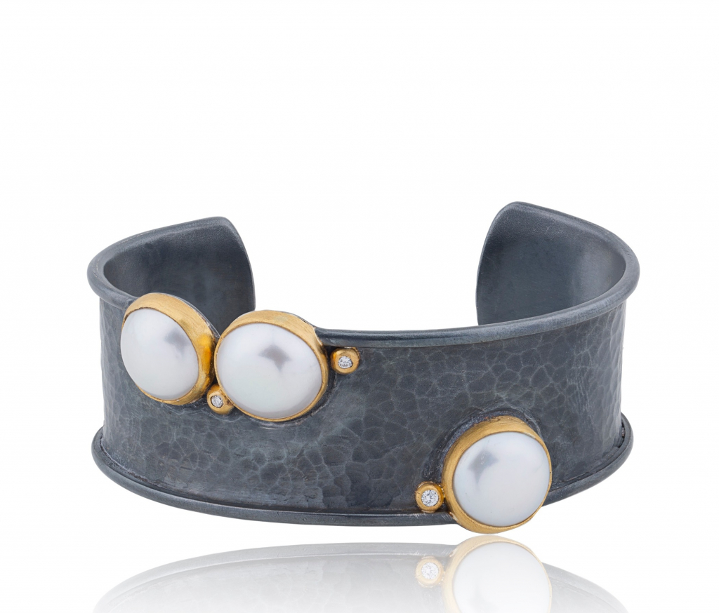 Kirsten cuff in oxidized silver and 24k gold with three white 13 mm freshwater pearls and 0.09 ct. t.w. diamonds, $1,890; Lika Behar, 201-933-7200, likabehar.com