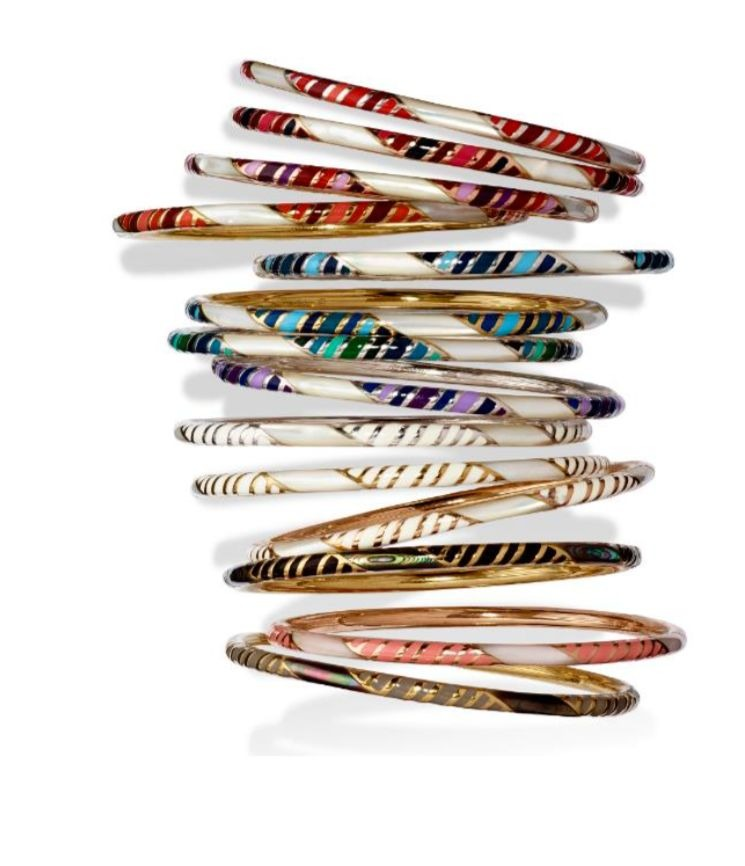 Stripe bangles in 18k gold-plated silver with hand-painted translucent ombre-effect enamel and mother-of-pearl or abalone inlay, $450 apiece; available online at Jan Leslie