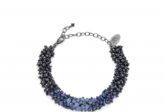 Ombré Cluster bracelet in oxidized sterling silver with hand-beaded gradient tones of blue sapphires with a lobster clasp and oval extension chain, £625; available online at Kate Wood Jewellery