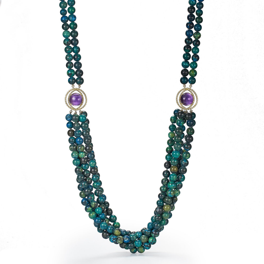 Starburst necklace in 18k yellow gold with 34 cts. t.w. blue-green azure-malachite beads and two large cabochon-cut amethysts, $8,500; available online at Daria de Koning Jewelry