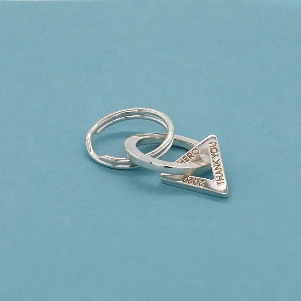Engravable Together charm in sterling silver, $150; available online at Elena Kriegner