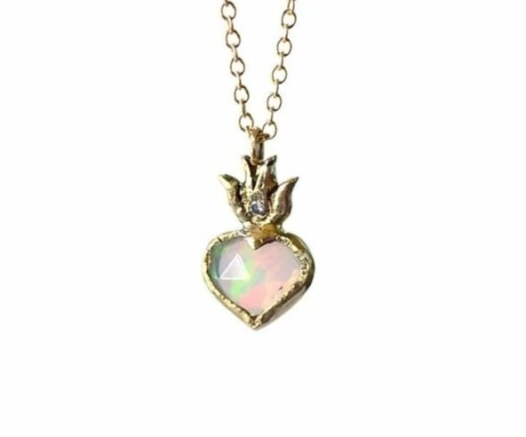 Sacred Heart pendant necklace in 14k yellow gold with a heart-shape opal and diamond-accented flames, $1,045; available online at Acanthus Jewelry