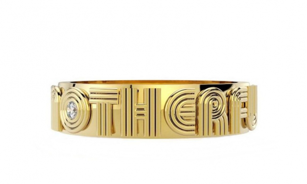 Motherfucker band in 14k yellow gold with a 0.025 ct. diamond, $955; available online at Alexa Sidaris