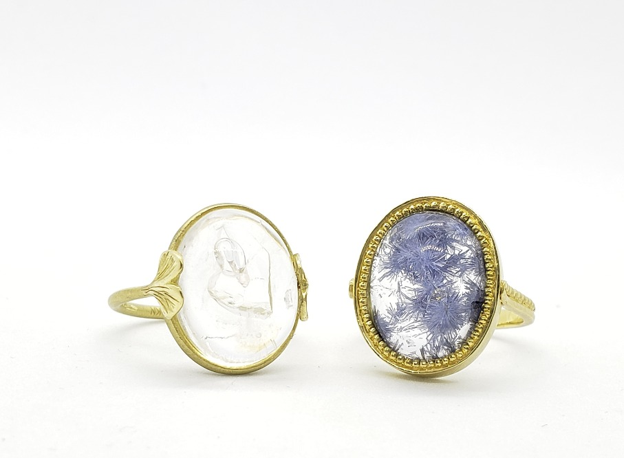 Rings in 18k yellow gold with a 5 ct. enhydro (water filled) quartz and an oversize Brazilian-origin dumortierite cabochon, $2,275–$3,520; email alisonknagasue@gmail.com for purchase