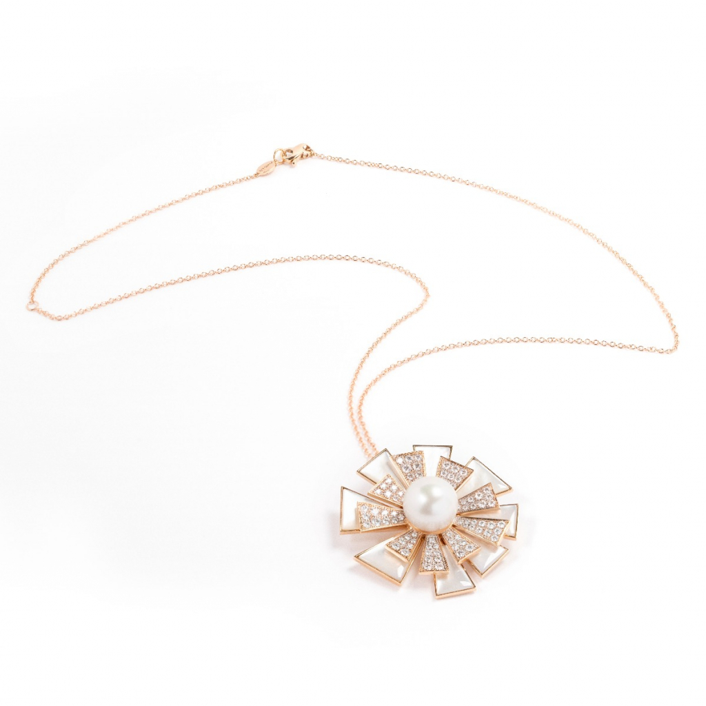 Flamante pendant necklace in 18k rose gold with mother-of-pearl, diamonds, and a white South Sea pearl, €15,700; email r.steri@utopia-jewels.com for purchase