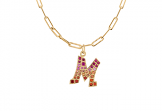 Grafitto initial charm in 14k gold with pink and orange sapphires on a paper-clip chain, $2,275; available online at Gigi Ferranti