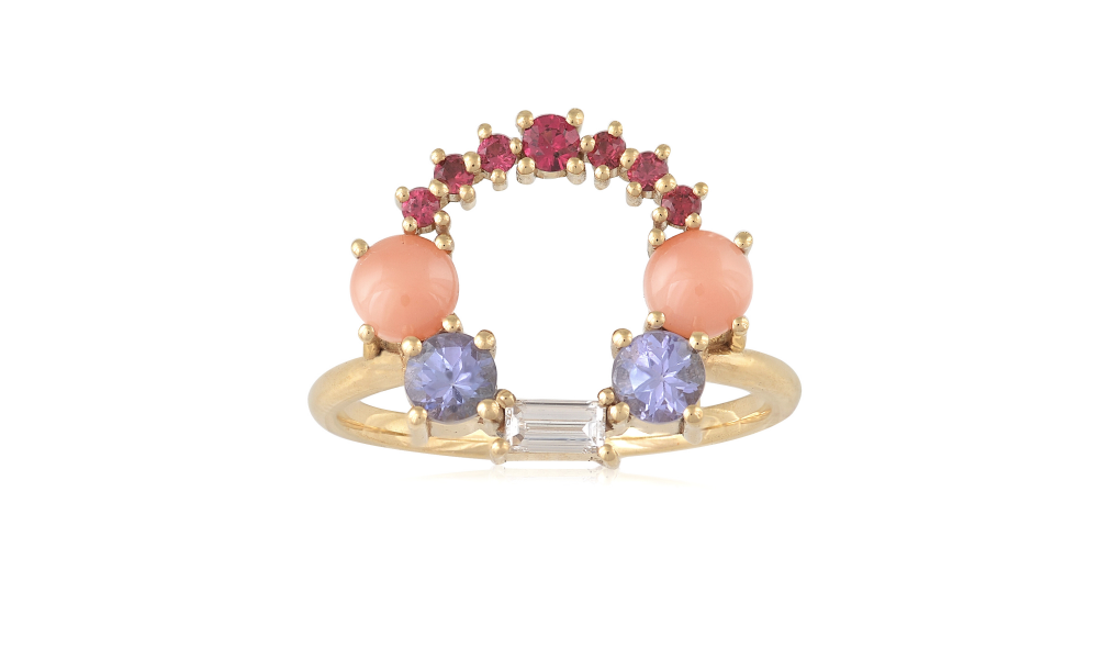Multi-stone ring in 18k yellow gold with 0.50 ct. t.w. round faceted tanzanite, and 0.18 ct. t.w. round faceted spinel, 0.14 ct. baguette-cut colorless diamond approx., and 0.06 ct. t.w. round cabochon-cut coral, €1,980; available online at Alexia Gryllaki